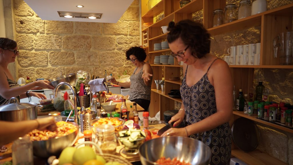 cooking together at sun and co. coliving